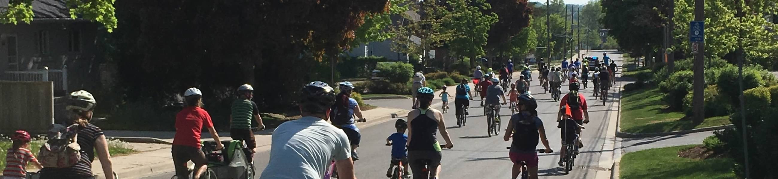 Community bike ride through a street in Orangeville