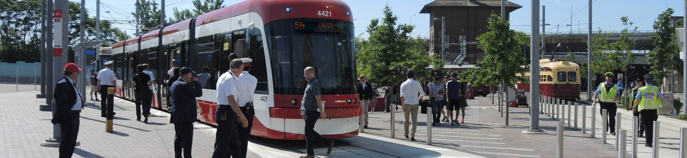 TTC Tram pulled up outside a stop